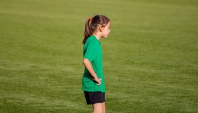 Little girl in a soccer training. In Burriana light beautiful cute game ball player girls kid practice tired female childhood youth exercise uniform person stock images