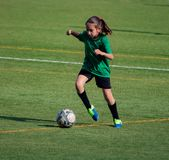 Little girl in a soccer training. In Burriana light beautiful cute game ball player girls kid practice tired female childhood youth exercise uniform person royalty free stock photos