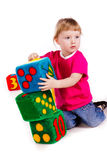 Little girl with soft blocks as a tower Stock Photo