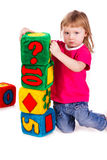 Little girl with soft blocks as a tower Stock Photography