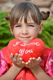 Little girl with a soft heart Royalty Free Stock Photos