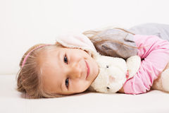 Little girl with soft toy Royalty Free Stock Photo