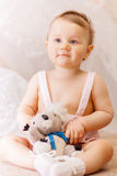 A Little girl with a soft toy bear Stock Images