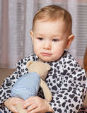 Little girl with a soft toy. A child holding a stuffed toy hands and dreams Stock Images