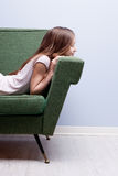 Little girl softly sleeping on a green sofa Stock Photography