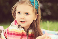 Little girl softly smiling Stock Photography