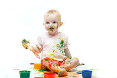 Little girl soiled by multi-colored paints Royalty Free Stock Image