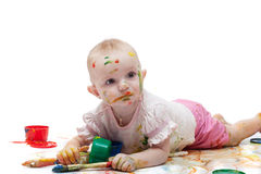 Little girl soiled by multi-colored paints Royalty Free Stock Photos