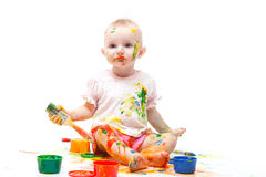 Little girl soiled by multi-colored paints Stock Photography