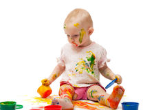 Little girl soiled by multi-colored paints Royalty Free Stock Photo