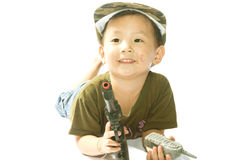Little girl with Soldier suit Stock Image