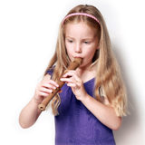 Little girl with soprano recorder Stock Images