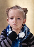 Little girl with sore throat. Looking sad Stock Photo