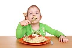 Little girl with spaghetti Stock Photos