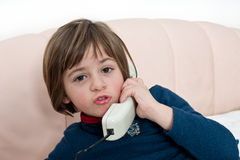 Little Girl Spaking at the Phone Royalty Free Stock Photography