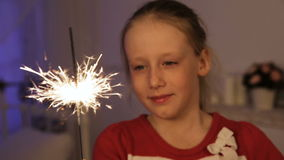 Little girl with sparklers. stock footage