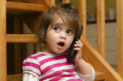 Little girl speak on the phone Stock Photos