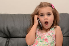 Little girl speak on the phone Royalty Free Stock Images