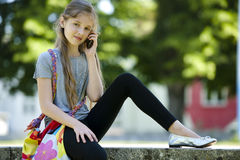 Little girl speaking on mobile phone Stock Image