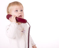 Little girl speaking on the phone Stock Photos