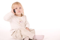 Little girl speaking on the phone Royalty Free Stock Images