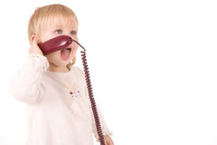 Little girl speaking on the phone Stock Photography