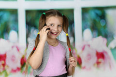 Little girl speaks by cell phone Royalty Free Stock Images