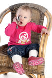Little girl speaks by a mobile phone Stock Photos