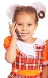 Little girl speaks on phone Royalty Free Stock Photos