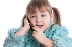 The little girl speaks by phone Stock Photo