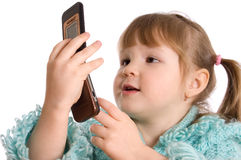 The little girl speaks by phone Royalty Free Stock Photography