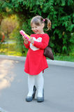 Little girl speaks by phone Royalty Free Stock Photography