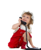 Little girl speaks on the phone Royalty Free Stock Photos
