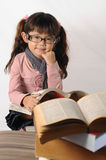 Little girl with spectacle Stock Image