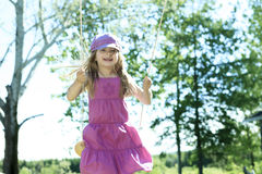 Little girl spending time outdoor Stock Images