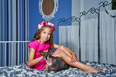 Little girl and sphinx cat Royalty Free Stock Photos