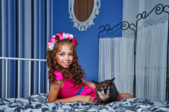 Little girl and sphinx cat Stock Photos