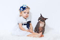 Little girl and sphinx cat Royalty Free Stock Image