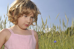 Little girl in spikes crops. Stock Image