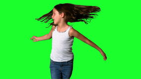 Little girl spinning around on green screen stock video footage