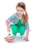 Little girl spinning dreidel Royalty Free Stock Photo