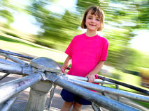 Little Girl on Spinning Merri-Go-Round. Little Girl Wearing Pink shirt on Spinning Merri-Go-Round Royalty Free Stock Image