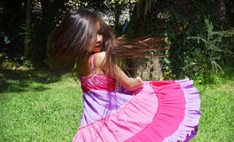 little girl spinning outside Stock Photo