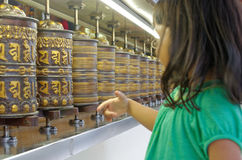 Little girl spinning prayer wheels. In thekchen choling temple, singapore Stock Images