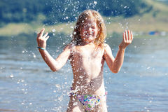 Little girl splashes in the water Royalty Free Stock Images