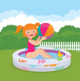 Little girl splashing in an inflatable pool in his backyard Royalty Free Stock Photography