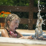 Little girl splashing Stock Photography