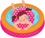 Little girl splashing in the summer inflatable pool Royalty Free Stock Photos