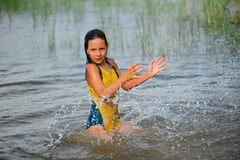 The little girl splashing with water Stock Photography