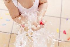 Little girl splashing a water ballon royalty free stock photo